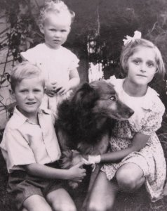 this picture (taken in 1940's) shows three children with a much loved family dog