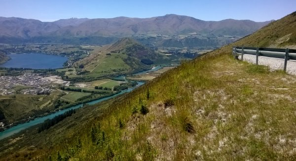 this pictures shows Lake Hayes and the Kawarau river from the road up to the Remarkables Ski area