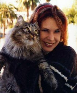this picture shows Ali Handal with her cat Indy