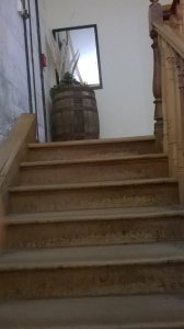 this picture shows the stairs and the barrel at the top of the Home Gallery Fine Arts.