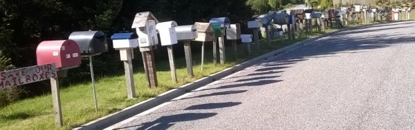 This picture shows a row of letterboxes from a Queenstown street